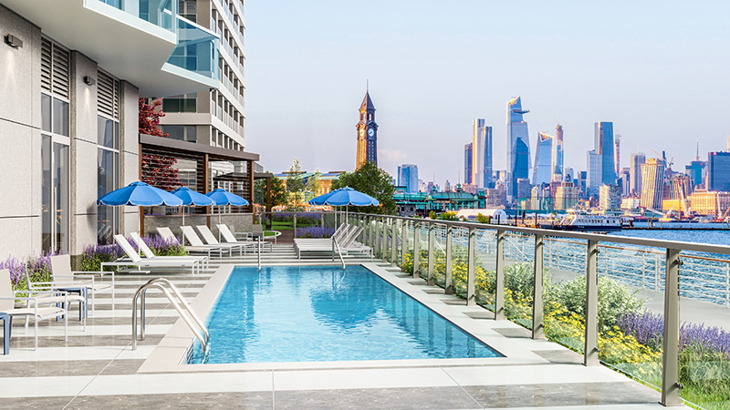 Outdoor pool deck at The Beach - Courtesy of Newport Leasing Office